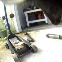 Luna The Wolfdog GoPro photo of a car jack